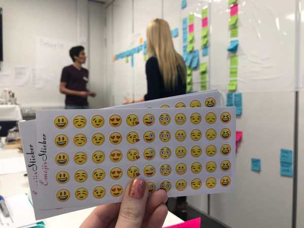 image of emoji stickers in front of someone facilitating